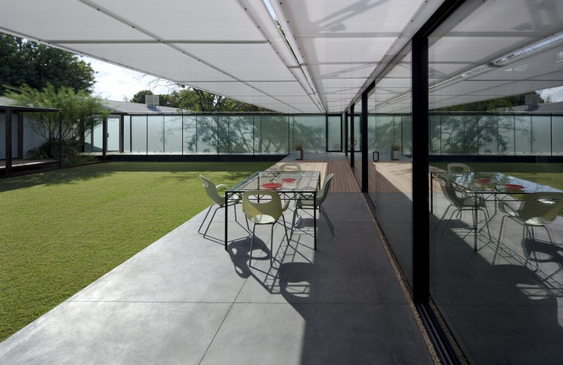 Patio with operable shade in open position