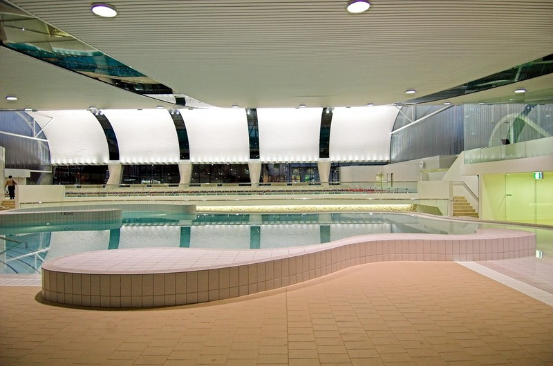 Nighttime view of main pool across recreation pool