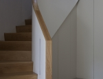 New stair case following curvatures of original stair case above.