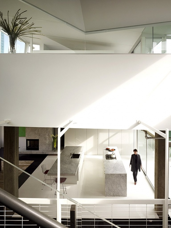 penthouse above and kitchen below from staircase
